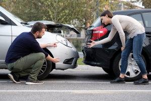 Two people arguing about their rear-end collision. Todd R. Durham Law Firm in Lewisville, Texas.
